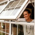 Woman looking out of a uPVC Casement Window